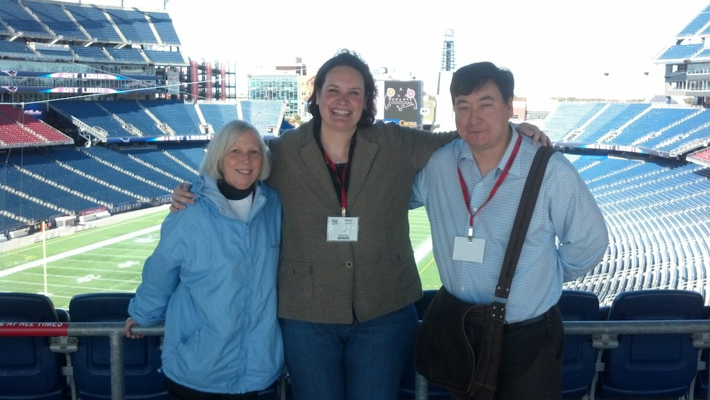 three presenters standing in front of Gillette Stadium